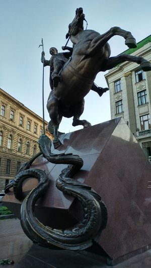 Architecture Building Exterior City Cityscape Dragon Fight Horse Outdoors Sculpture Snake Spear Statue Win Winner