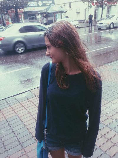 Woman looking at city street