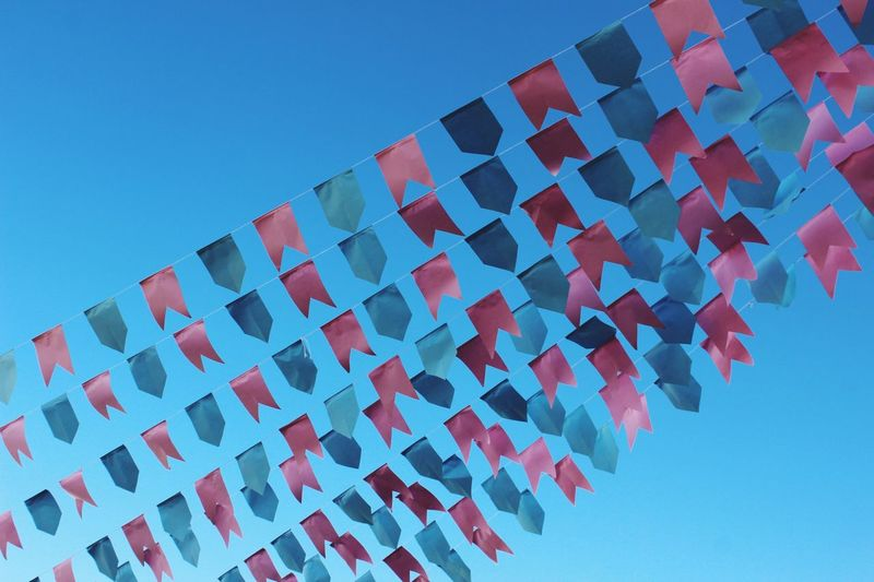 Low Angle View Blue Architecture Day No People Clear Sky Sky Outdoors Patriotism Building Exterior Flags Sky And Clouds Decoration Paper Breathing Space Breathing Space