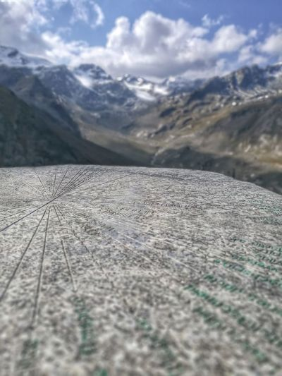 Alto Adige Arrow Südtirol Tablet Alps Arrow Symbol Beauty In Nature Close-up Cold Temperature Day Direction Landscape Mountain Mountain Range Nature No People Outdoors Scenics Sky Snow Tranquil Scene Tranquility Travel Destinations Winter