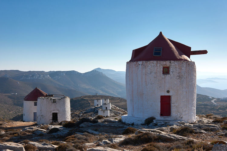 Amorgos Windmill Amorgos Architecture Belief Building Building Exterior Built Structure Day Greece House Landscape Mountain Mountain Range Nature No People Outdoors Place Of Worship Religion Sky Spirituality Sunlight Tower