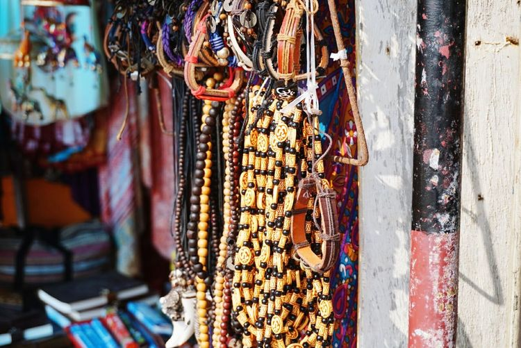 Close-up of bracelets hanging for sale at store