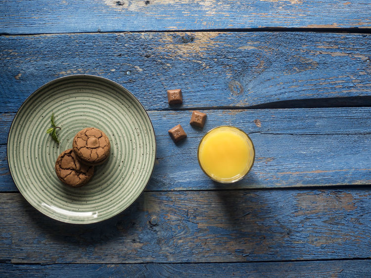plate with browny, fresh orange juice on blue painted plank table Juice Orange Painted Blue Bowl Browny Close-up Day Directly Above Drink Food Food And Drink Fresh Freshness Grunge Healthy Eating High Angle View Indoors  No People Nut Nut - Food Planke Plate Refreshment Retro Styled Still Life Style Table Vintage Wellbeing Wood - Material Wooden