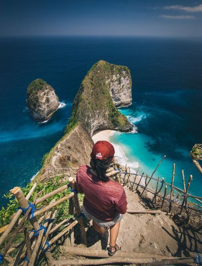 High angle view of woman by sea against sky