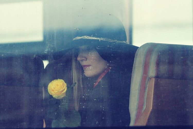 Jorney is a flower Travel Only Women One Woman Only One Person Young Adult Train Window Train Journey Women Of EyeEm Women Who Inspire You Women Around The World Women Portraits Street Photography Behind Window WeekOnEyeEm Paint The Town Yellow