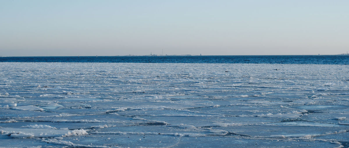 Kaivopuisto seafront in February Ice Floe Winter Sea Horizon Clear Sky Horizon Over Water Snow No People 2.35:1 Cinematic Cinematic Photography Helsinki Kaivopuisto Finnish Nature Lighthouse In The Distance Buoy Ice Cold Ice Frozen Sea Melting Sea Ice Cold Temperature Water Seafront Gh5