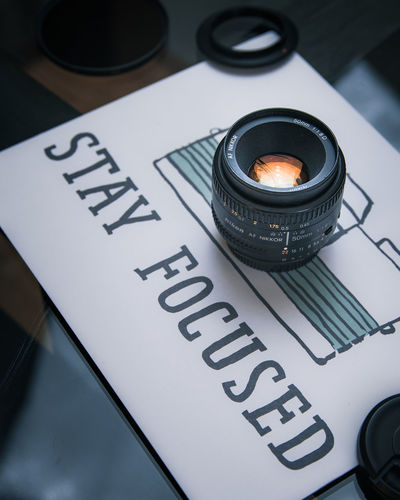 Stay Focused Text Western Script Still Life High Angle View Camera - Photographic Equipment Photography Themes Communication Focus On Foreground Close-up No People Technology Black Color Photographic Equipment Indoors  Table The Media Information Selective Focus Capital Letter Day Lens Flare Concept Conceptual Conceptual Photography  EyeEm Best Shots EyeEm Selects EyeEm Gallery Nikon D7500 50mm