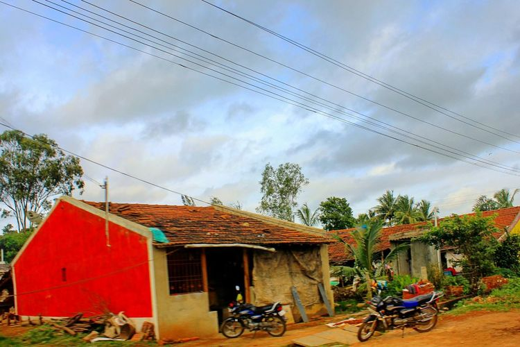 With clouds we come home. Architecture Transportation Built Structure House Building Exterior Land Vehicle Tree Mode Of Transport Motor Scooter Sky Poverty Motorcycle Village Road Power Line  Roadside Cloud - Sky Cloud Day Rural Scene Home Is Where The Art Is Home Rural Scenes