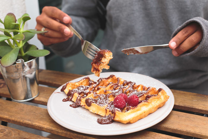 Eating Waffle Close-up Day Dessert Food Food And Drink Fork Freshness Holding Human Body Part Human Hand Indoors  Indulgence Midsection One Person People Plate Ready-to-eat Real People SLICE Sweet Food Table Temptation Unhealthy Eating