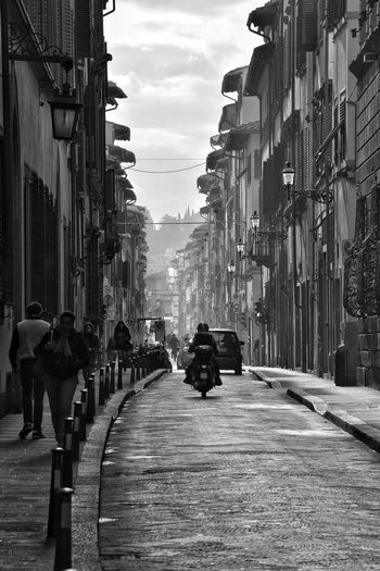 Florence Street By Day Blackandwhite Best City In The World Monochrome Atmospheric Transportation Street Street View Bollards Pavement Roadside Into The Distance Car City Outdoors The Way Forward Day Architecture Building Exterior Large Group Of People People Sky Adult Built Structure Road Real People