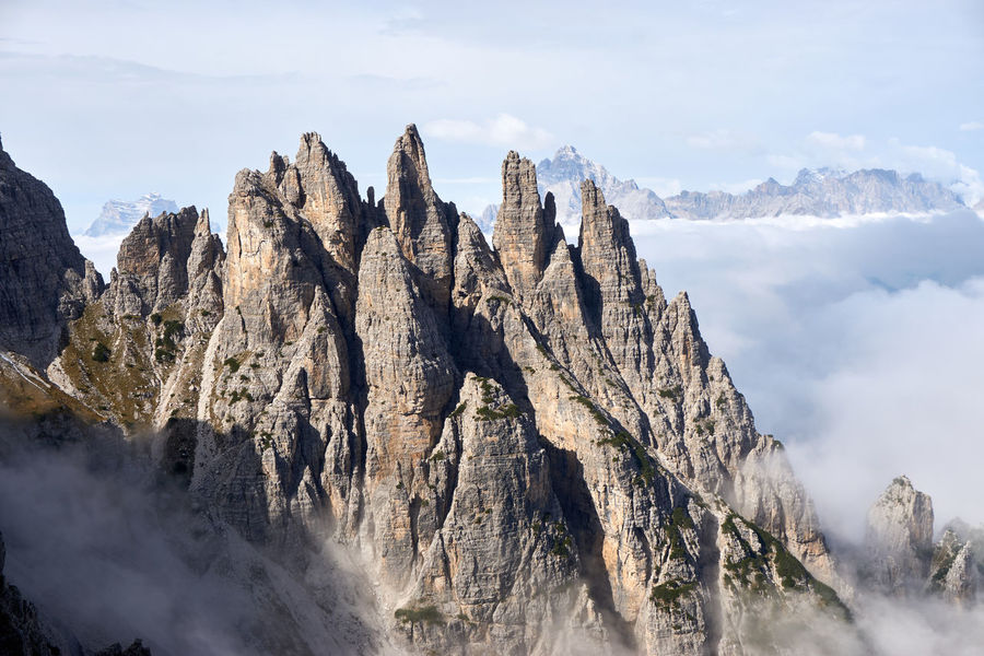 The beautiful towers of Castello di Vedorcia, in the Spalti di Toro range of the Dolomites, shot from the normal route to Campanile Toro. Mt. Pelmo and Mt. Antelao, among the highest and most iconic of the Dolomites, lurk in the background. Antelao Dolomites, Italy Pelmo Spalti Di Toro Clouds Dolomiti Landscape Marmarole Mountains First Eyeem Photo