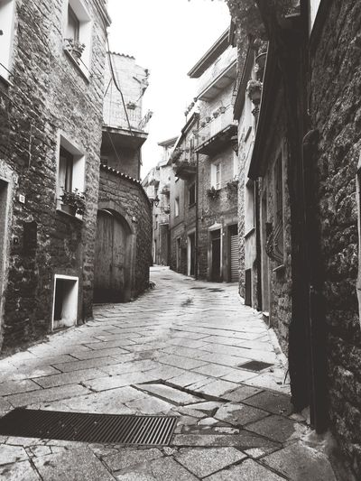Walk between past and present Building Exterior Architecture The Way Forward Direction Day Street Cobblestone Town