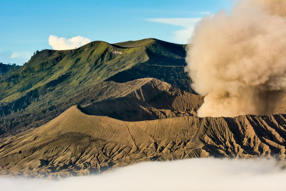 Eruption at Mountain Bromo Indonesia in Juli 2016 Beauty In Nature Bromo Mountain Bromo Mountain Indonesia Day Erupting Geology Gunung Bromo INDONESIA Indonesia Scenery Indonesia_photography Indonesian Photographers Collection Mountain Nature No People Outdoors Physical Geography Scenics Smoke - Physical Structure THREATS Travel Destinations Volcano