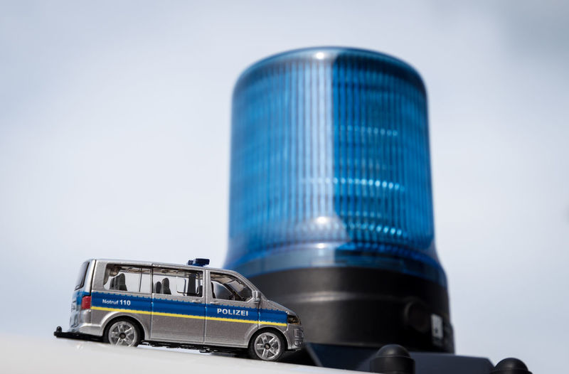 Low angle view of police toy car by emergency light against sky