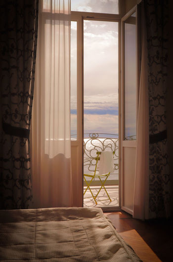 View of sea seen through window of house