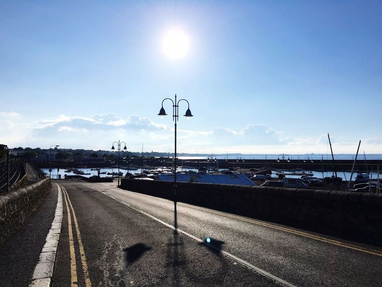 Street Light Sun Sunny Transportation Road The Way Forward Street Sunlight Road Marking Sky Cloud Diminishing Perspective Day Blue Long Tranquil Scene Outdoors Vanishing Point Non-urban Scene Tranquility Harbour Boats