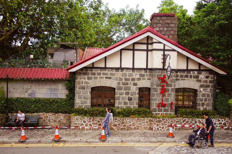 It's going to rain! April Showcase Architecture Building Exterior Cafe Chimney Chinese City Life Colonial Day Exterior Green Here Belongs To Me HongKong House Old Outdoors Patio Peak Street Streetphotography Thepeak Tree Walking Wheelchair Windows