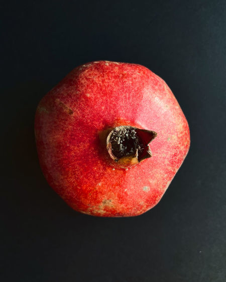 Close-up of red apple against black background