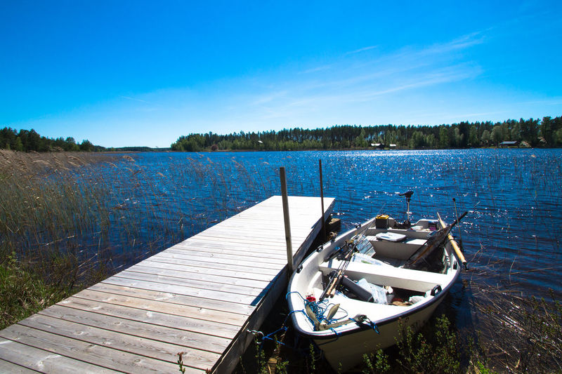 Beauty In Nature Blue Boat Day Fishing Fishing Boat Lake Nature Nature Naturelovers No People Outdoor Outdoors Scenics Sky Summer Summertime Sweden Sweden Nature Sweden-landscape Tranquil Scene Tranquility Transportation Tree Water