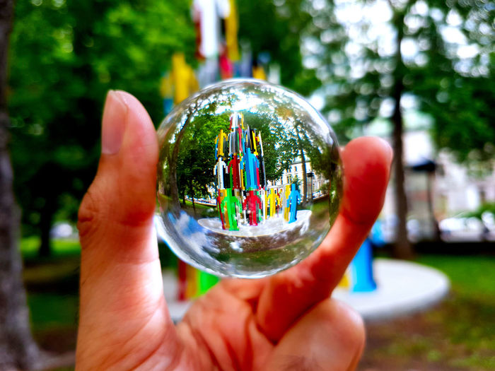 Close-up of person hand holding glass of crystal ball