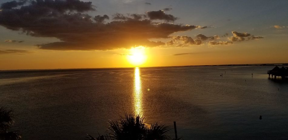 Sunset Sun Reflection Sky Cloud - Sky Silhouette Gold Colored Sunlight Scenics Beach Dramatic Sky Tranquility Nature Sea Landscape Water Beauty In Nature Outdoors Summer Tranquil Scene