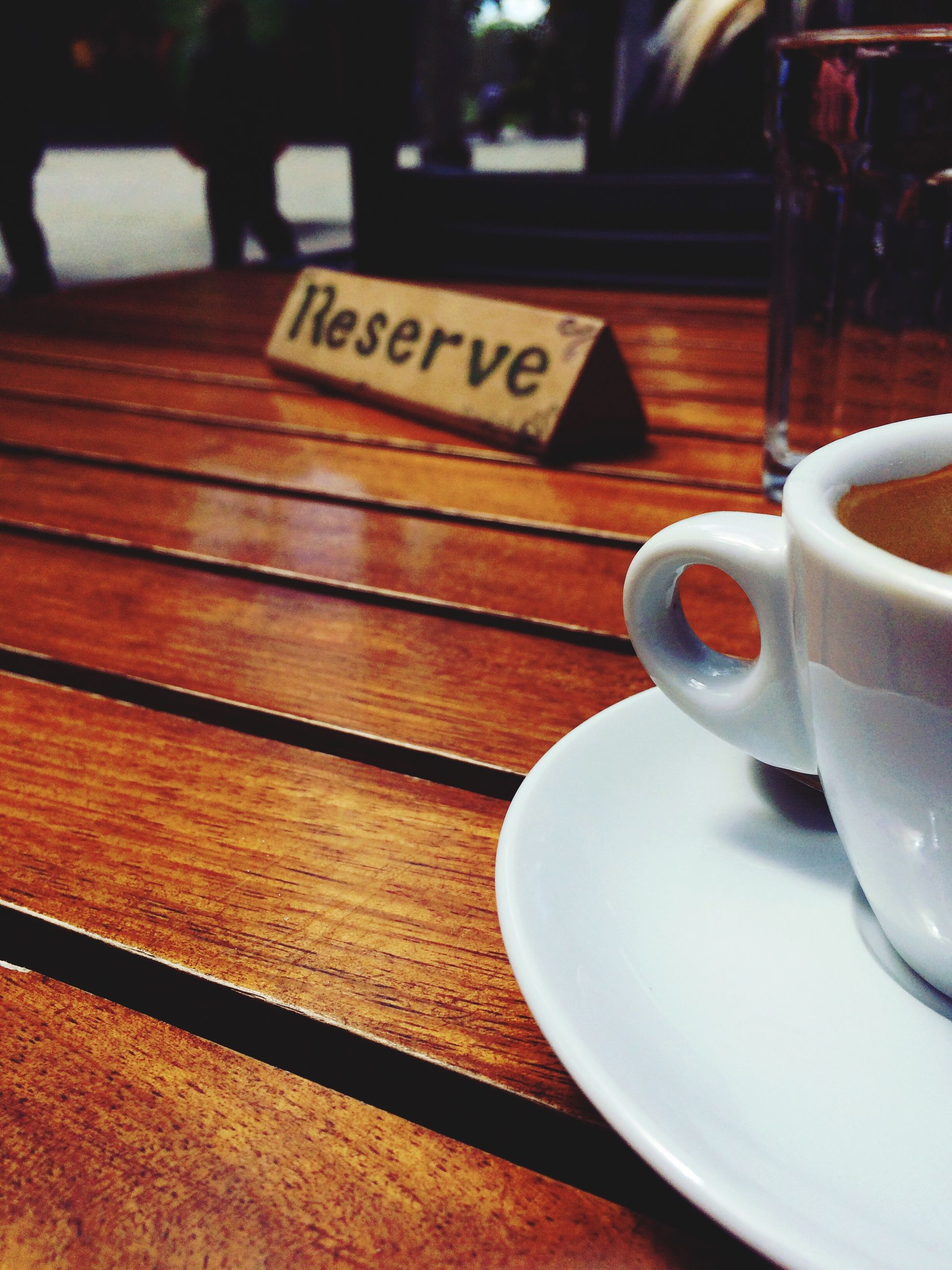 table, drink, coffee cup, food and drink, refreshment, indoors, saucer, coffee - drink, wood - material, cafe, focus on foreground, text, still life, close-up, coffee, freshness, wooden, cup, restaurant, western script