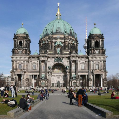 Tourists in front of berlin cathedral against sky