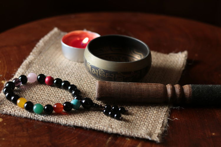 tibetan Buddhism singing bowl and chanting beads on sack cloth Chanting Wooden Sticks Candle Light Chanting Bead Mantras Mini Mantra Om Mani Padme Hum Red Candles