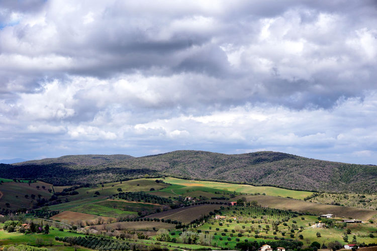 View from Montiano, Italy onto the tuskanian landscape Cloud - Sky Sky Environment Landscape Beauty In Nature Tranquil Scene Mountain No People Non-urban Scene Rural Scene Tuscany Montiano Scenics - Nature Nature Tranquility Plant Land Outdoors Tourist Destination Green Color Blue Dramatic Sky Dramatic Landscape Toskana Toscana Italy Travel Travel Destinations