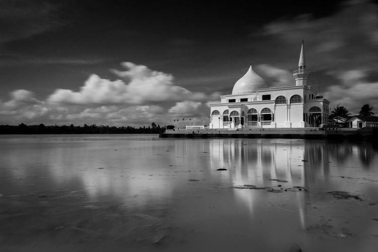 Brunei mosque at kelantan Architecture Belief Building Building Exterior Built Structure Cloud - Sky Dome Lake Nature No People Outdoors Place Of Worship Reflection Religion Sky Spire  Spirituality Travel Destinations Water Waterfront