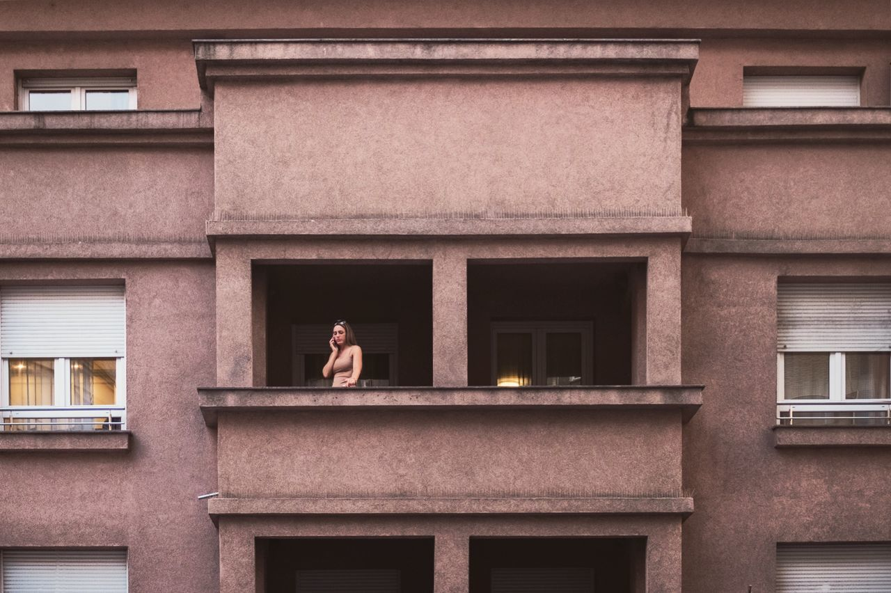 architecture, real people, building exterior, built structure, lifestyles, one person, day, outdoors, leisure activity, full length, front view, standing, women, men, young women, young adult, mammal
