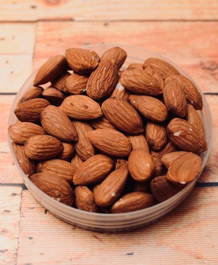 almond nut with wooden background Food And Drink Food Healthy Eating Freshness Still Life Wellbeing Large Group Of Objects Nut Table Bowl Close-up Brown Abundance Indoors  Heap Almond Nut - Food No People High Angle View Container