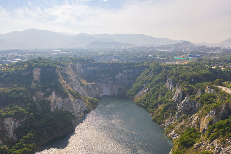 High angle view of river amidst mountains against sky
