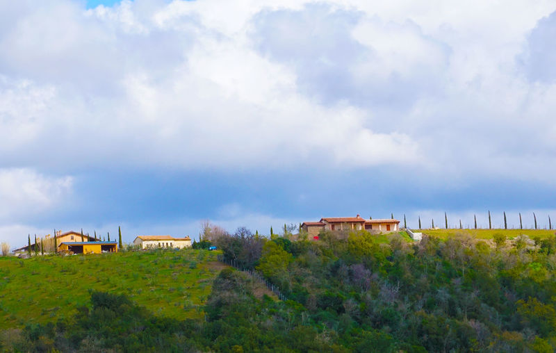 houses on a hill in Tuscany, Italy Cloud - Sky Architecture Built Structure Sky Building Exterior Nature Building Plant No People House Land Day Tree Field Landscape Green Color Beauty In Nature Scenics - Nature Growth Environment Outdoors Tuscany Tranquil Scene Italy Tourism Travel