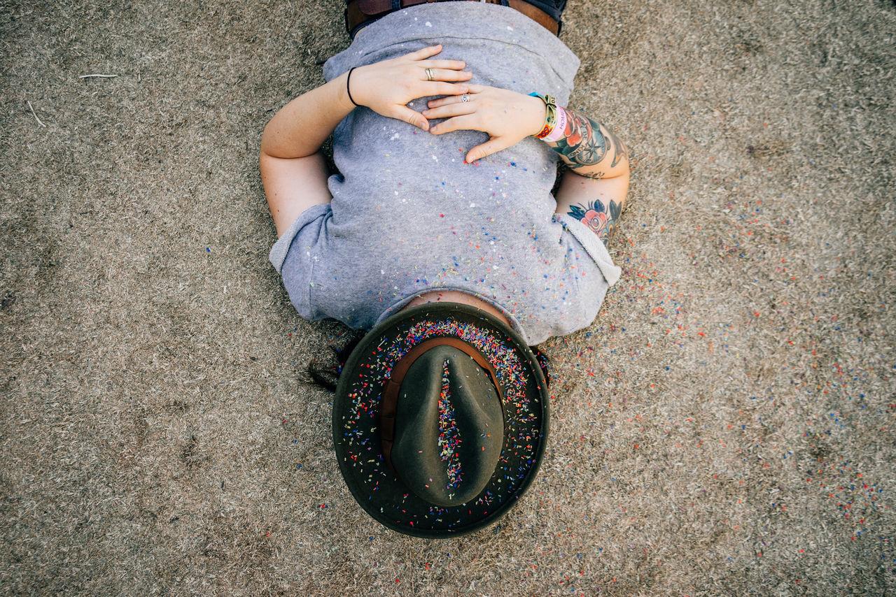High angle view of woman lying on beach