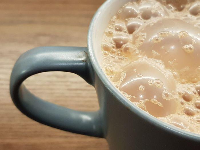"""Pulled tea or """"teh tarik"""" Table Wood Frothy Milk Milktea Brown Sweet Pulled Tea Teh Tarik Cup Mug Baverage Drink Froth Art Hot Drink Foam Coffee Tea Froth Beverage"""