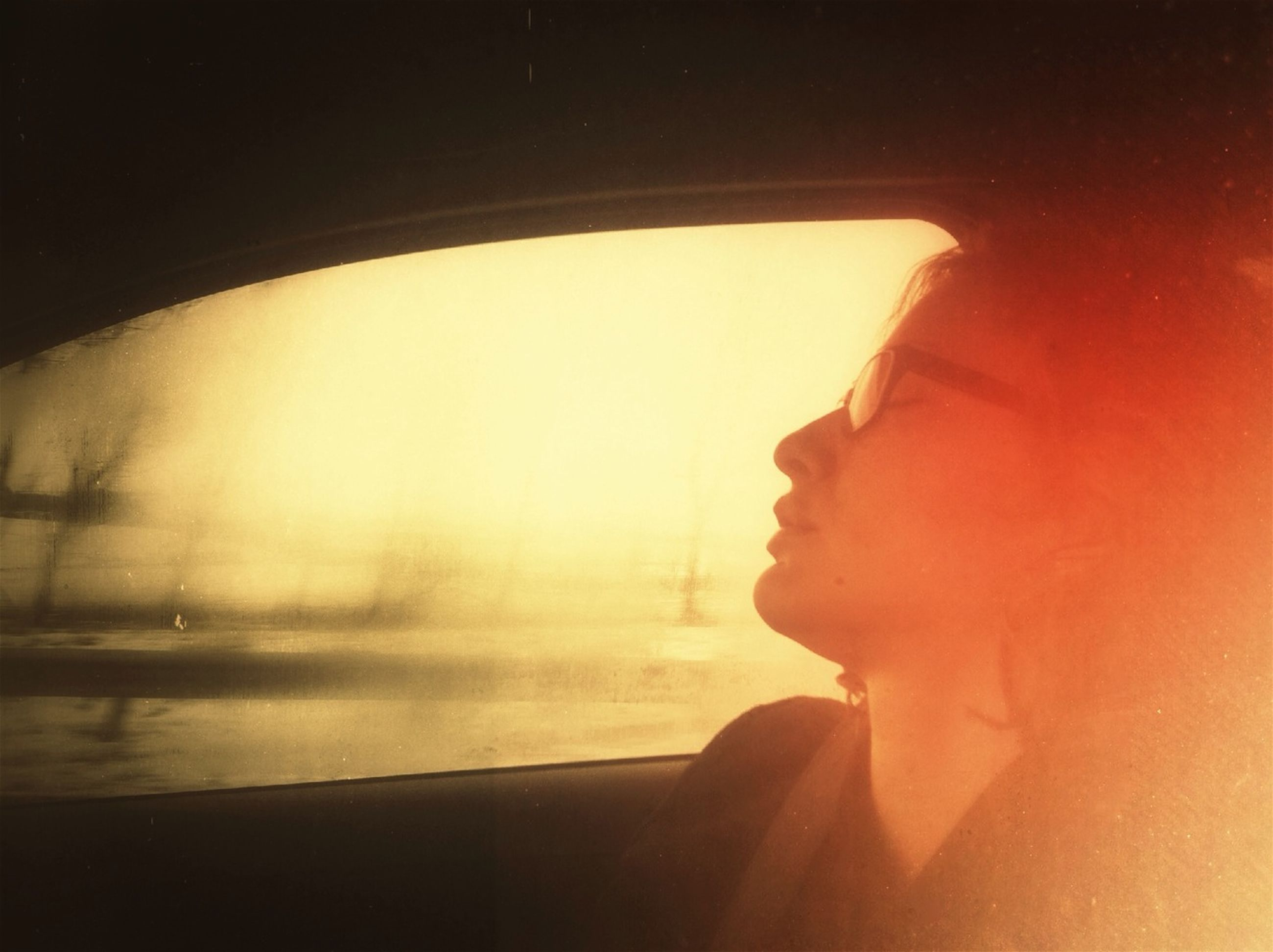 lifestyles, indoors, leisure activity, window, headshot, water, reflection, side view, young adult, part of, young women, holding, vehicle interior, person, glass - material, close-up, sunset