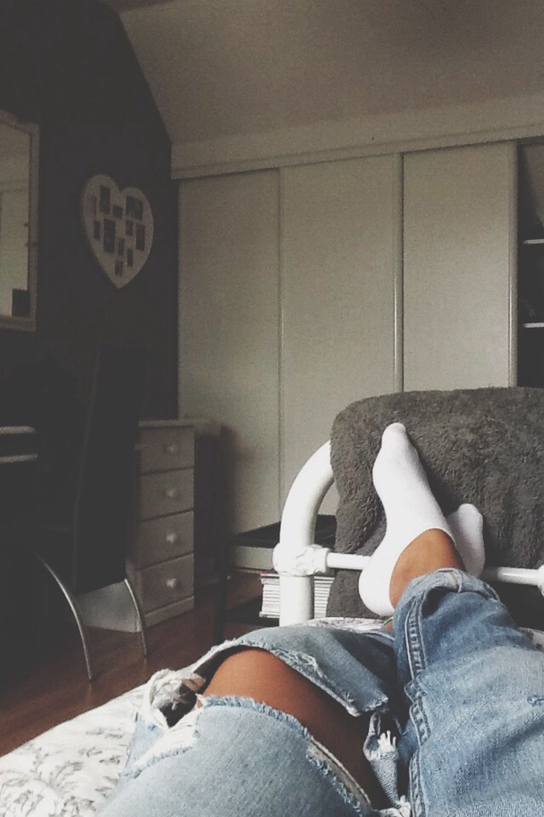low section, men, lifestyles, person, sitting, shoe, indoors, personal perspective, leisure activity, casual clothing, relaxation, standing, jeans, unrecognizable person, human foot