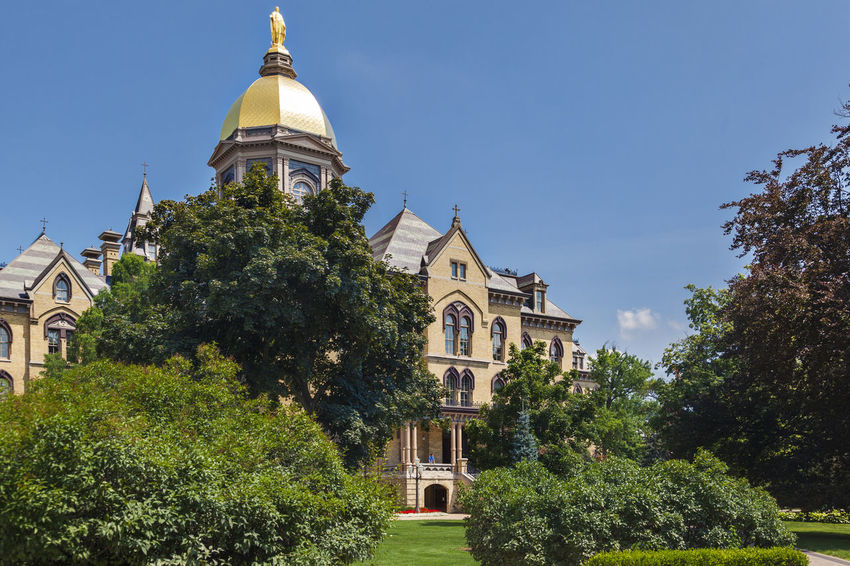 University of Notre Dame USA Color Outdoor Green Blue Sky Campus Christian Culture Famous Tree Education Knowledge Religion Sunny Day Golden Tower Building Green Grass Horizontal Composition Lawn Main Building Science And Technology University Of Notre Dame U\ Us