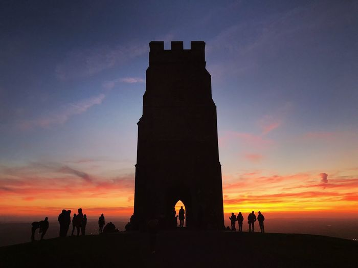 Glastonbury tor Spirituality Beautiful Sunsets Glastonbury Sunset Sunset Sky Group Of People Real People Orange Color Silhouette Nature Women Cloud - Sky Beauty In Nature Travel Destinations Lifestyles Architecture Large Group Of People Leisure Activity The Past Men Crowd Tourism