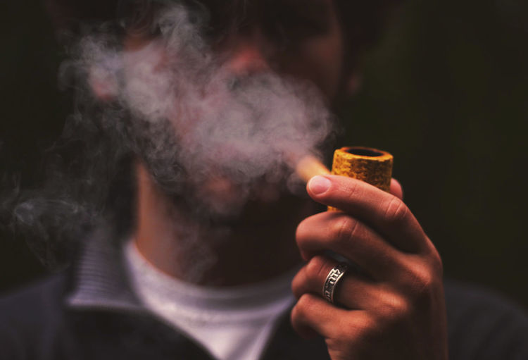 From a quiet Saturday morning in the garden. Addiction Adult Bad Habit Cigar Close-up Day Holding Human Hand Indoors  Lifestyles Men One Person People Real People Smoke - Physical Structure Smoking - Activity Smoking Issues Live For The Story