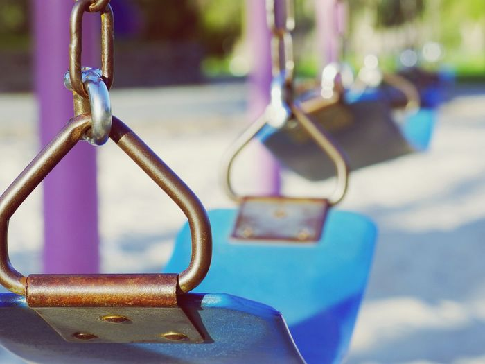 Empty swings Metal Focus On Foreground Close-up City No People Outdoors Day Playground Playground Equipment Whittier Narrow Recreational Park Daylight Geometric Shapes Swing Swings Blurry Metallic Childhood School Day Park