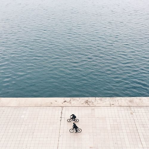 High angle view of bicycling against rippled water