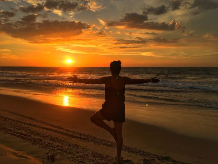 Sunrise Sea Beauty In Nature Yoga Beach Water Real People Lifestyles Sand Outdoors Peruvian style and freedom!!!!!