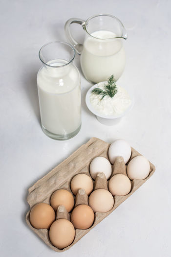 High angle view of eggs in jar on table