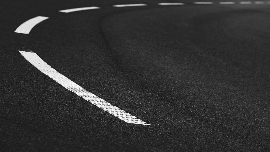 Road Road Marking Asphalt Transportation No People Marking White Color Guidance Dividing Line Single Line Close-up Rules Lines And Shapes Simplicity Street Corner Round Shape Blackandwhite