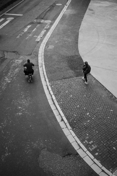 City Road Street High Angle View Real People Transportation Sign Symbol Marking Road Marking Lifestyles Day Full Length People Men Walking One Animal Outdoors Riding Streetphotography Blackandwhite