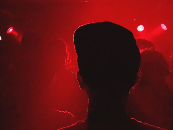 Rear view of man in illuminated red light