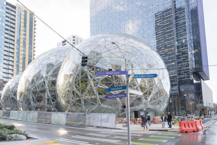 Amazon Spheres located in downtown Seattle at the world headquarters with direction indicators for the area. Architecture Campus Condominiums Economy Employee Giant Growing Jeff Bezos Modern Shopping Terrariums Amazon Design Editorial  Expansion Green Houses Internet Spheres Technology World Headquarters