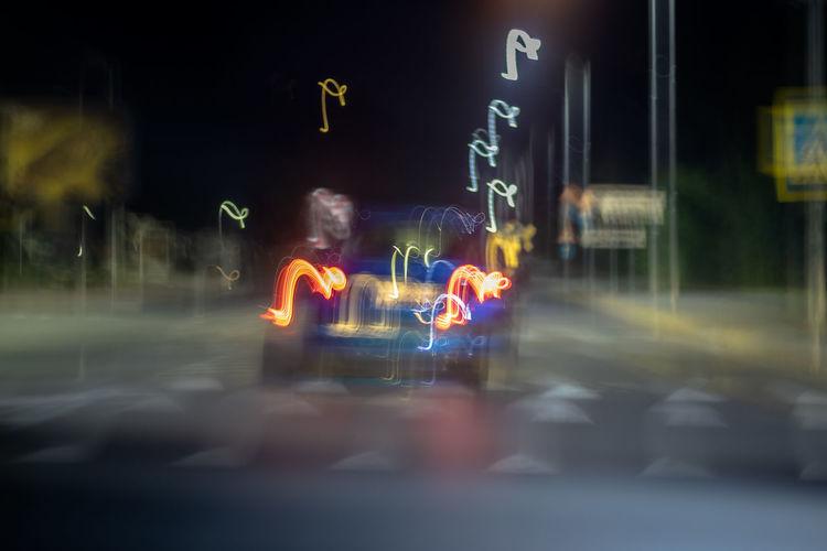 Multi colored light trails on city street